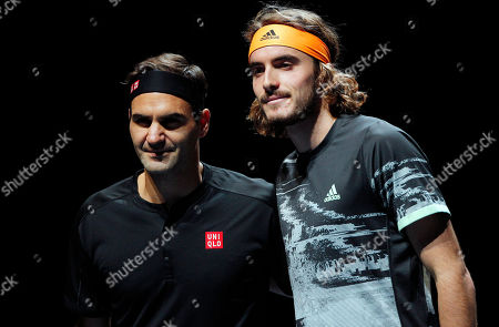 Stock Picture of Stefanos Tsitsipas of Greece stands with Roger Federer of Switzerland at the net