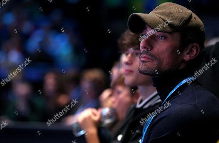 Model David Gandy watches the tennis