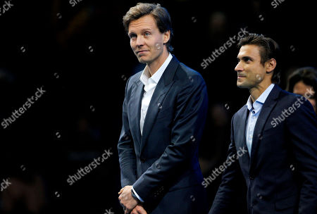 Stock Picture of Tomas Berdych of Czech Republic stands with David Ferrer of Spain at the retirement ceremony