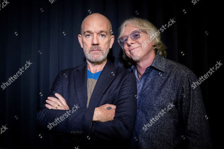 Michael Stipe, Mike Mills. This photo shows Michael Stipe and Mike Mills, from R.E.M. posing for a portrait in New York