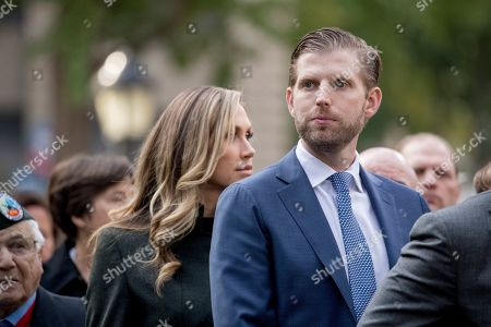 Eric Trump, the son of President Donald Trump, and his wife Lara Yunaska Trump, left, watch as President Donald Trump and first lady Melania Trump participate in a wreath laying ceremony at the New York City Veterans Day Parade at Madison Square Park, in Washington
