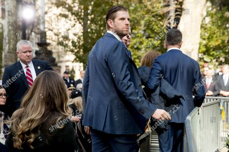 Eric Trump, the son of President Donald Trump, and his wife Lara Trump, left, arrive before President Donald Trump and first lady Melania Trump participate in a wreath laying ceremony at the New York City Veterans Day Parade at Madison Square Park, in Washington