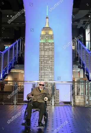 Sesame Street's Big Bird and puppeteer Caroll Spinney participate in the ceremonial lighting of the Empire State Building in honor of Sesame Street's 50th anniversary, in New York