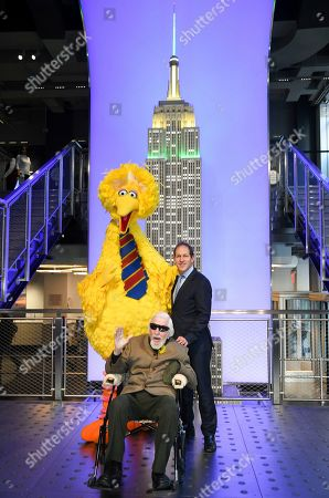 Big Bird, Caroll Spinney, Steve Youngwood. Sesame Street's Big Bird and puppeteer Caroll Spinney, center, and Sesame Workshop president of media & education and CEO Steve Youngwood participate in the ceremonial lighting of the Empire State Building in honor of Sesame Street's 50th anniversary, in New York