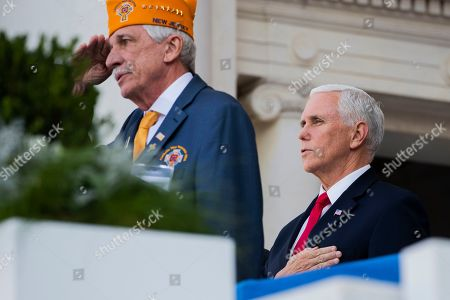 Mike Pence, Francis Kowalski. Vice President Mike Pence recites the Pledge of Allegiance with Francis Kowalski, national commander of Catholic War Veterans of the U.S. during the 66th annual National Veterans Day observance at Arlington National Cemetery, in Arlington, Va