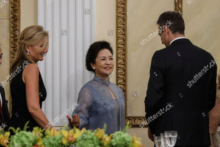 Stock Image of Peng Liyuan, Kyriakos Mitsotakis, Mareva Grabowski-Mitsotakis. Chinese First Lady Peng Liyuan, center is welcomed by Greek Prime Minister Kyriakos Mitsotakis, right and his wife Mareva Grabowski-Mitsotakis during a State Dinner at the presidential palace in Athens,. China and Greece signed 16 bilateral agreements Monday outlining cooperation in a broad range of sectors during a visit by Chinese President Xi Jinping aimed at furthering a major global investment initiative inside the European Union