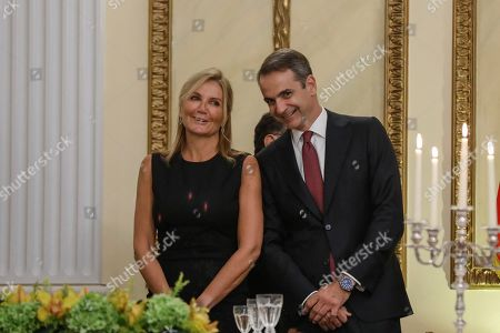 Kyriakos Mitsotakis, Mareva Grabowski-Mitsotakis. Greek Prime Minister Kyriakos Mitsotakis, and his wife Mareva Grabowski-Mitsotakis attend a State Dinner at the presidential palace in Athens,. China and Greece signed 16 bilateral agreements Monday outlining cooperation in a broad range of sectors during a visit by Chinese President Xi Jinping aimed at furthering a major global investment initiative inside the European Union