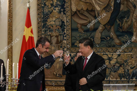 Xi Jinping, Kyriakos Mitsotakis. Chinese President Xi Jinping, right, and Greek Prime Minister Kyriakos Mitsotakis toast during a State Dinner at the Greek presidential palace in Athens,. China and Greece signed 16 bilateral agreements Monday outlining cooperation in a broad range of sectors during a visit by Chinese President Xi Jinping aimed at furthering a major global investment initiative inside the European Union