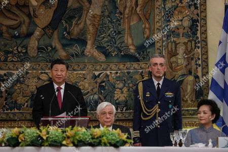Xi Jinping, Prokopis Pavlopoulos, Peng Liyuan. Chinese President Xi Jinping, left, speaks during a State Dinner as Greek President Prokopis Pavlopoulos, second left, and Chinese First Lady Peng Liyuan, right, listen at the Greek presidential palace in Athens,. China and Greece signed 16 bilateral agreements Monday outlining cooperation in a broad range of sectors during a visit by Chinese President Xi Jinping aimed at furthering a major global investment initiative inside the European Union