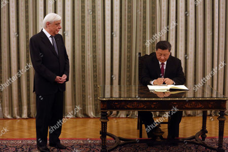 Chinese President Xi Jinping (R) signs the guest book in the presence of Greek President Prokopis Pavlopoulos (L) before the official dinner at the Presidential Palace in Athens, Greece, 11 November 2019. The Chinese President is paying a two-day official visit to Greece.
