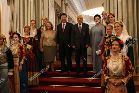 Greek President Prokopis Pavlopoulos (C-R) Chinese President Xi Jinping (C-L) and their spouses Chinese First Lady Peng Liyuan (R) and Greek First Lady Vlassia Pavlopoulou-Peltsemi along with the Lykeion Ellinidon ladies before the official dinner at the Presidential Palace in Athens, Greece, 11 November 2019. The Chinese President is paying a two-day official visit to Greece.
