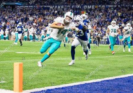 Miami Dolphins quarterback Ryan Fitzpatrick (14) runs with the ball for a touchdown as Indianapolis Colts cornerback Kenny Moore (23) pursues during NFL football game action between the Miami Dolphins and the Indianapolis Colts at Lucas Oil Stadium in Indianapolis, Indiana. Miami defeated Indianapolis 16-12