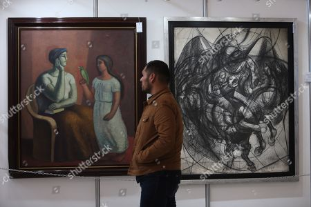 Stock Image of Artworks on display as part of a Latin American art auction in Mexico City, Mexico, 11 November 2019. The unpublished oil painting 'Le livre de chevet' (lit.: The header book) by Mexican nationalized English artist Leonora Carrington will head the Latin American art auction that will be held in Mexico City on 14 November 2019.