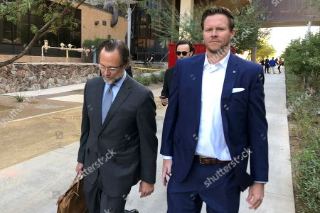 """Stock Photo of Paul Petersen, Kurt Altman. Maricopa County Assessor Paul Petersen, right, along with his attorney, Kurt Altman, leave after Petersen's arraignment hearing in Phoenix. Ronald Rasband, a leader in The Church of Jesus Christ of Latter-day Saints, told The Arizona Republic the church leadership has found the human smuggling charges against Maricopa County Assessor Paul Petersen """"sickening"""
