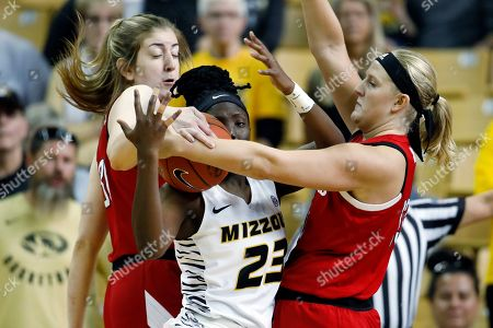 Nebraska's Kate Cain, left, and Ashtyn Veerbeek, right, double team Missouri guard Amber Smith (23) during an NCAA women's basketball game, in Columbia, Mo