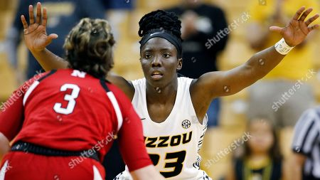Missouri guard Amber Smith (23) defends against Nebraska guard Hannah Whitish (3) during an NCAA women's basketball game, in Columbia, Mo