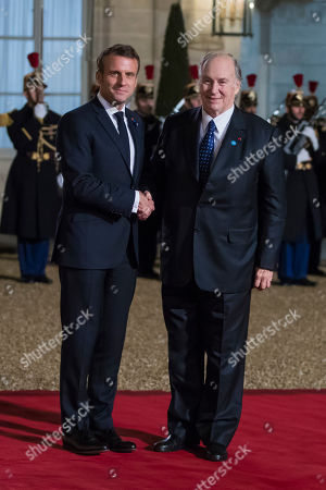 French President Emmanuel Macron (L) welcomes Prince Prince Karim Aga Khan (R) for a dinner held with participants of the Paris Peace Forum, at the Elysee Palace, in Paris, France, 11 November 2019.