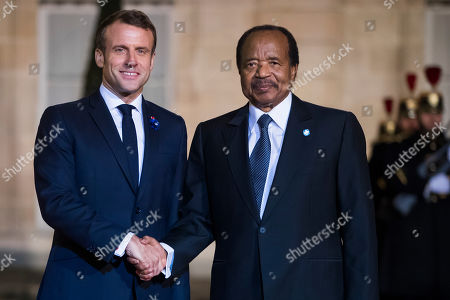French President Emmanuel Macron (L) welcomes Cameroon President Paul Biya (R) for a dinner held with participants of the Paris Peace Forum, at the Elysee Palace, in Paris, France, 11 November 2019.