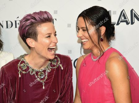 Megan Rapinoe, Ali Krieger. Megan Rapinoe, left, and Ali Krieger attend the Glamour Women of the Year Awards at Alice Tully Hall, in New York