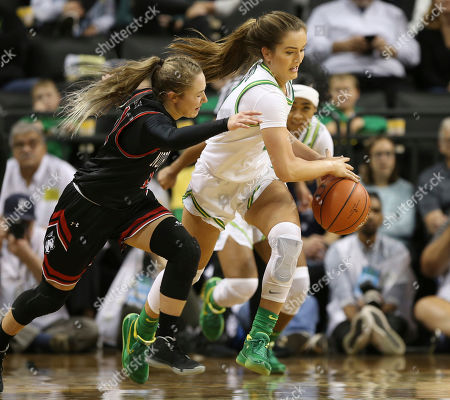Northeastern's Stella Clark, left, has the ball stolen by Oregon's Taylor Chavez, center, with Oregon's Minyon Moore, right, during the second quarter of an NCAA college basketball game in Eugene, Ore
