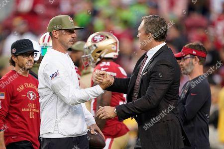 San Francisco 49ers head coach Kyle Shanahan, left, greets general manager John Lynch before an NFL football game against the Seattle Seahawks in Santa Clara, Calif