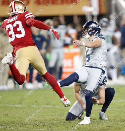 Stock Photo of Seattle Seahawks kicker Jason Myers (R) kicks the game winning field goal in over-time as San Francisco 49ers free safety Tarvarius Moore (L) tries to block during the NFL American Football game between the Seattle Seahawks and San Francisco 49ers at Levi's Stadium in Santa Clara, California, USA, 11 November 2019.
