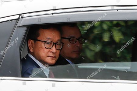 Cambodia's exiled opposition leader Sam Rainsy looks out from a car as he arrive at Parliament House in Kuala Lumpur, . Sam Rainsy landed in Kuala Lumpur in a bid to return to his homeland after Thailand had earlier blocked him from entering