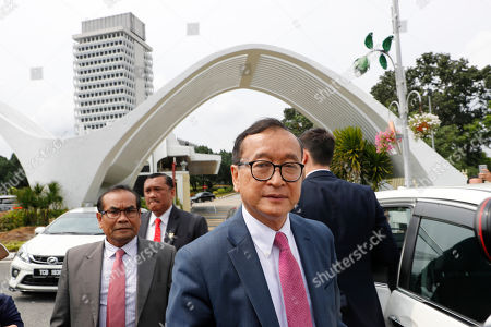 Cambodia's exiled opposition leader Sam Rainsy is asked for comments outside Parliament House in Kuala Lumpur, Malaysia, . Rainsy landed in Kuala Lumpur in a bid to return to his homeland after Thailand had earlier blocked him from entering
