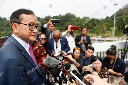 Cambodia's exiled opposition leader Sam Rainsy talks to the media outside Parliament House in Kuala Lumpur, Malaysia, . Rainsy landed in Kuala Lumpur in a bid to return to his homeland after Thailand had earlier blocked him from entering