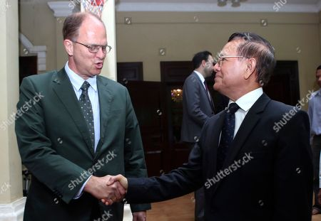 Stock Picture of Kem Sokha, Christian Berger. German Ambassador to Cambodia Christian Berger, left, shakes hands with Cambodia National Rescue Party's Kem Sokha, right, after a welcome meeting in his house in Phnom Penh, Cambodia, . Kem Sokha was freed Sunday by court order after more than two years in detention without trial