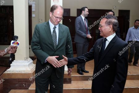 Stock Image of Kem Sokha, Christian Berger. German Ambassador to Cambodia Christian Berger, left, shakes hands with Cambodia National Rescue Party's Kem Sokha, right, after a welcome meeting in his house in Phnom Penh, Cambodia, . Kem Sokha was freed Sunday by court order after more than two years in detention without trial