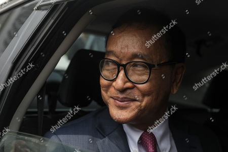Self-exiled former Cambodian opposition leader Sam Rainsy (L) leaves the Parliament building in Kuala Lumpur, Malaysia, 12 November 2019. Sam Rainsy, former leader of Cambodia's largest opposition party, the Cambodia National Rescue Party, chose self-imposed exile for a second time in 2016, in order to avoid a series of convictions he says are politically motivated.