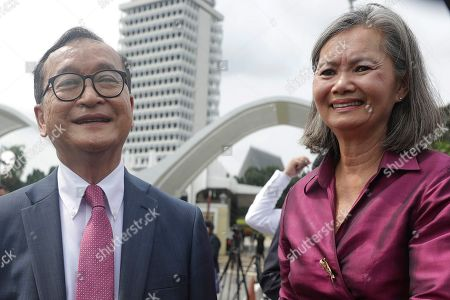 Self-exiled former Cambodian opposition leader Sam Rainsy (L) and Cambodian opposition lawmaker Mu Sochua (R) speak to the media outside the Parliament building in Kuala Lumpur, Malaysia, 12 November 2019. Sam Rainsy, former leader of Cambodia's largest opposition party, the Cambodia National Rescue Party, chose self-imposed exile for a second time in 2016, in order to avoid a series of convictions he says are politically motivated.