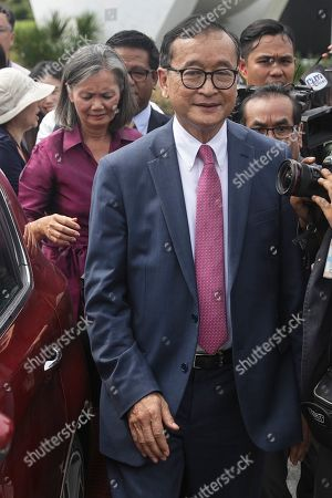 Self-exiled former Cambodian opposition leader Sam Rainsy (R) and Cambodian opposition lawmaker Mu Sochua (L) leave after speaking to the press outside the Parliament building in Kuala Lumpur, Malaysia, 12 November 2019. Sam Rainsy, former leader of Cambodia's largest opposition party, the Cambodia National Rescue Party, chose self-imposed exile for a second time in 2016, in order to avoid a series of convictions he says are politically motivated.