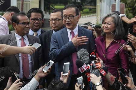 Self-exiled former Cambodian opposition leader Sam Rainsy (C) and Cambodian opposition lawmaker Mu Sochua (C-R) speak to the media outside the Parliament building in Kuala Lumpur, Malaysia, 12 November 2019. Sam Rainsy, former leader of Cambodia's largest opposition party, the Cambodia National Rescue Party, chose self-imposed exile for a second time in 2016, in order to avoid a series of convictions he says are politically motivated.