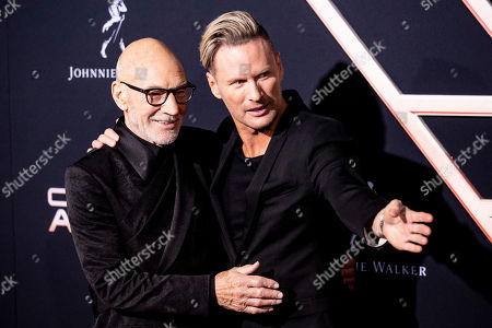 Patrick Stewart (L) and US composer Brian Tyler (R) interact on the red carpet during the premiere of 'Charlie's Angels' at the Westwood Regency Theater in Los Angeles, California, USA, 11 November 2019. The movie is to be released in US theaters on 15 November.