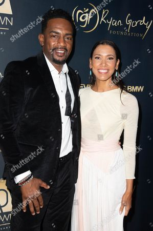Stock Picture of Bill Bellamy and wife Kristen Baker Bellamy attend the Ryan Gordy Foundation 60 Years of Motown Celebration at the Waldorf Astoria in Beverly Hills
