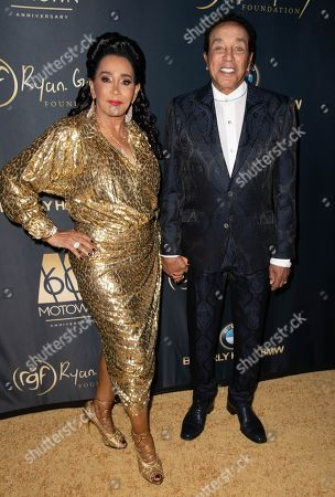 Stock Photo of Frances Glandney and Smokey Robinson attend the Ryan Gordy Foundation 60 Years of Motown Celebration at the Waldorf Astoria in Beverly Hills