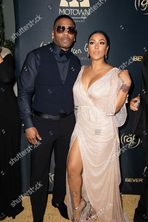 Stock Picture of Nelly and Shantel Jackson attend the Ryan Gordy Foundation 60 Years of Motown Celebration at the Waldorf Astoria in Beverly Hills