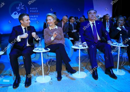 European Commission president Ursula von der Leyen, second left, listens to French President Emmanuel Macron, left, while Tajik President Emomali Rahmon and Cameroon's President Paul Biya, right, look on at the start of the Paris Peace Forum in Paris
