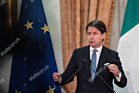 Italian Prime Minister Giuseppe Conte, attends a media conference with German Chancellor Merkel (not seen) following their meeting at Villa Doria Pamphilj in Rome