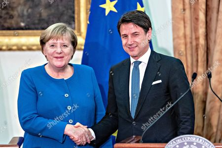 Italian Prime Minister Giuseppe Conte and German Chancellor Angela Merkel attend a joint media conference following their meeting at Villa Doria Pamphilj in Rome