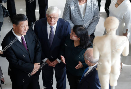 China's President Xi Jinping, left, accompanied by his Greek counterpart Prokopis Pavlopoulos, centre, visits the Acropolis Museum during his two-day official visit to Greece, in Athens