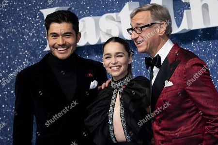 Henry Golding, Emilia Clarke, Paul Feig. Henry Golding, Emilia Clarke and Paul Feig pose for photographers upon arrival at the premiere of the film 'Last Christmas' in London