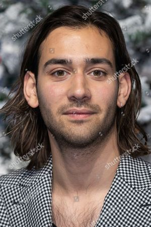 Stock Photo of Maxim Baldry poses for photographers upon arrival at the premiere of the film 'Last Christmas' in London