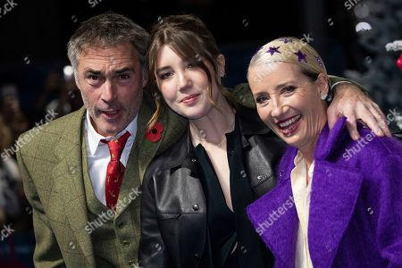 Greg Wise, Gaia Wise, Emma Thompson. Greg Wise, Gaia Wise and Emma Thompson pose for photographers upon arrival at the premiere of the film 'Last Christmas' in London