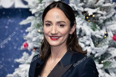 Lydia Leonard poses for photographers upon arrival at the premiere of the film 'Last Christmas' in London