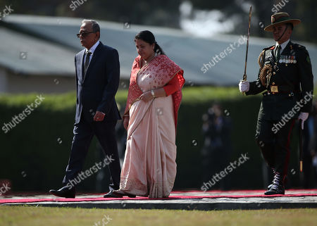 President of Bangladesh Abdul Hamid (L) walks with Nepal's President Bidhya Devi Bhandari (C) to inspect the guard of honor during a welcome ceremony at Tribhuvan International Airport in Kathmandu, Nepal, 21 November 2019.