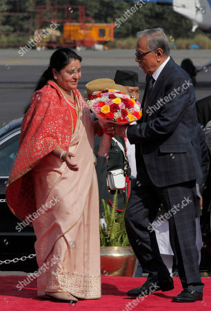 President of Bangladesh Abdul Hamid (R) receives a bouquet from Nepalese president Bidhya Devi Bhandari (L) during a welcome ceremony at Tribhuvan International Airport in Kathmandu, Nepal, 21 November 2019. Hamid is on a three-day official goodwill visit to Nepal at the invitation of Nepal's President Bidhya Devi Bhandari.