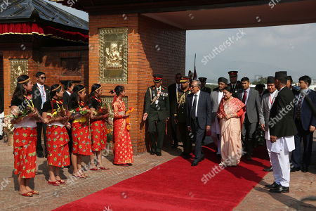Nepalese president Bidhya Devi Bhandari (C, right) receives President of Bangladesh Abdul Hamid (C) during a welcome ceremony at Tribhuvan International Airport in Kathmandu, Nepal, 21 November 2019. Hamid is on a three-day official goodwill visit to Nepal at the invitation of Nepal's President Bidhya Devi Bhandari.